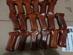 really Nice Polish Bakelite AK Pistol grips Gloss clearcoat. Orangish red, redish orange